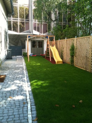 A new play space and elegant path, with clever screening of the wall